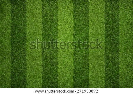 Striped soccer field texture, background with copy space - stock photo