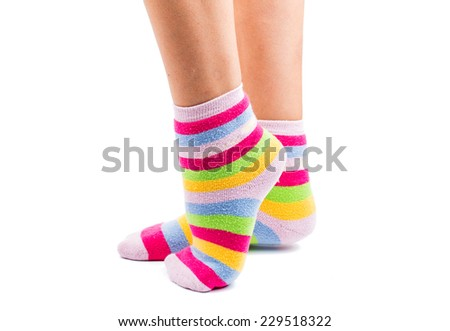 striped socks on the feet isolated on white background - stock photo