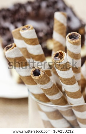 Striped wafer rolls, delicious chocolate snack - stock photo