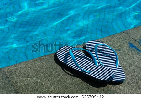 Stripped flip-flop summer shoes on poolside