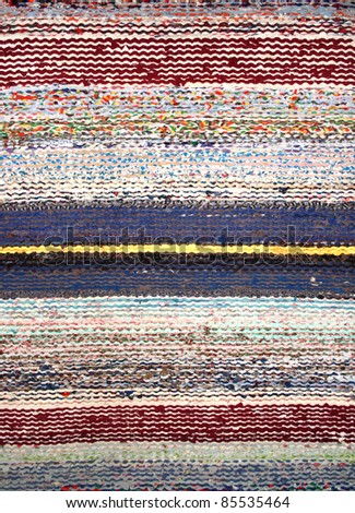 Stripped woven rag rug closeup - stock photo