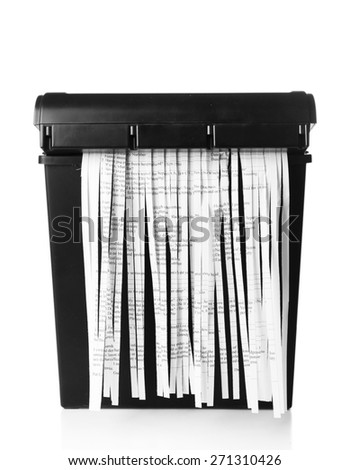 Strips of destroyed paper from shredder isolated on white - stock photo