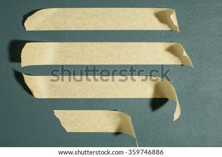Strips of masking tape. Isolated on blackboard. - stock photo