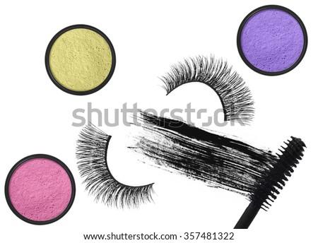 Stroke (sample) of black mascara, eyeshadows and false eyelash isolated on white macro - stock photo