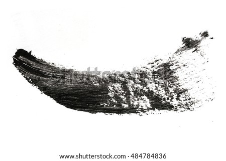 Stroke (sample) of black mascara, isolated on white
