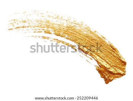 Strokes of golden paint isolated on white background - stock photo
