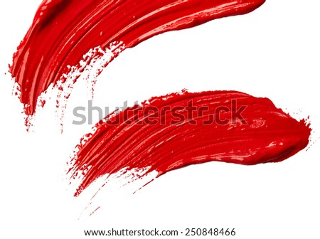 Strokes of red paint isolated on white background - stock photo