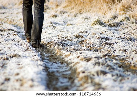 Stroller in the winter on country lane been cold - stock photo