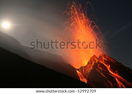 Stromboli volcano at full-moon with eruption - stock photo