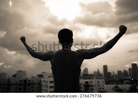 Strong and confident man in the city.  - stock photo