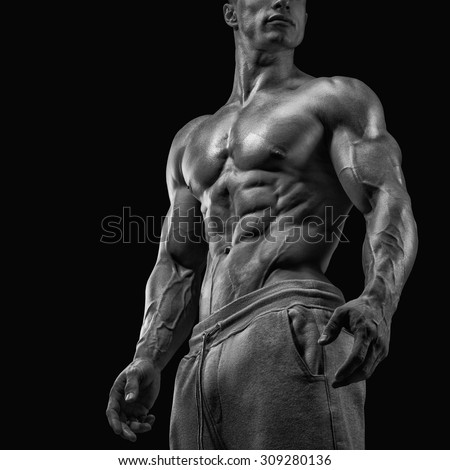 Strong and handsome young man with muscles and biceps. Close-up of a power fitness man. Black and white photo - stock photo