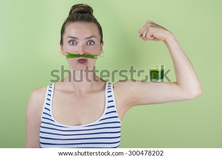 Strong and healthy with a wheatgrass power shot - stock photo