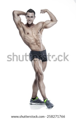 Strong Athletic Man Fitness Model Torso showing six pack abs. and posing isolated over white background - stock photo