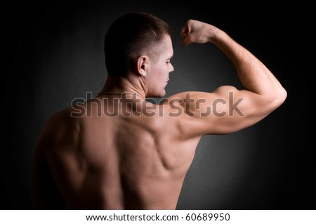 strong athletic man on black - stock photo