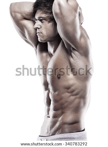 Strong Athletic Man  showing muscular body and sixpack abs over clean background - stock photo