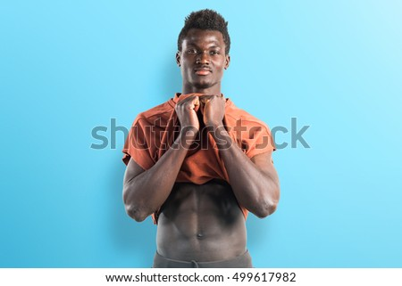 Strong black man on blue background