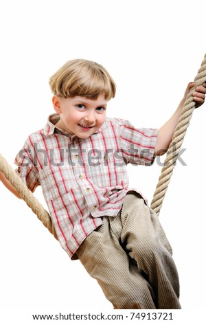 strong boy sitting on the rope - stock photo