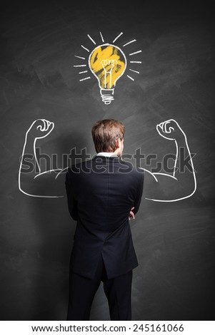 strong businessman having an idea - stock photo