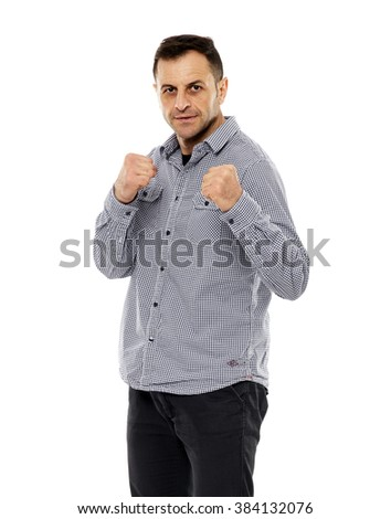 Strong businessman in guard stance with fists up, ready to fight - stock photo