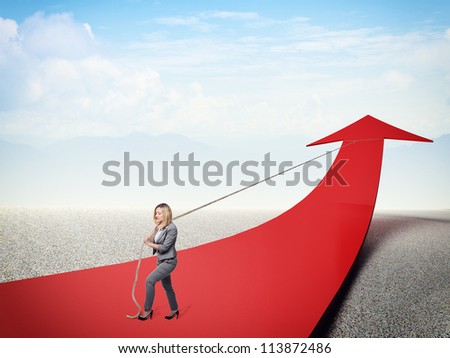 strong businesswoman pull 3d red arrow - stock photo