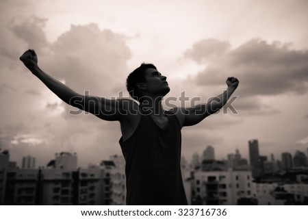 Strong confident man in the city.  - stock photo