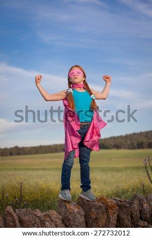 strong confident super hero girl child concept - stock photo