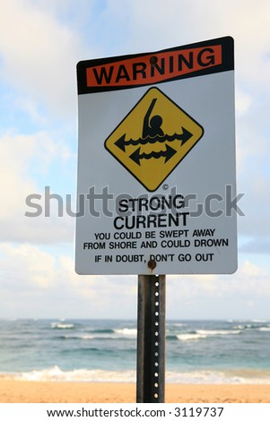 Strong current sign on the beach - stock photo