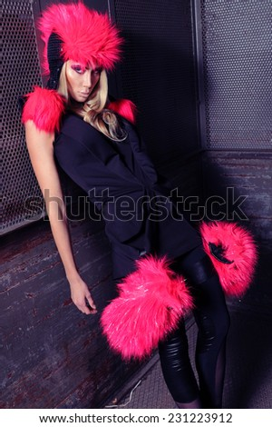 Strong fashion woman in black dress with pink cap and gloves - stock photo