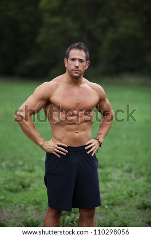 Strong fitness man taking a break from his workout - stock photo