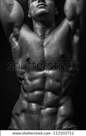 Strong male abs in black and white - stock photo
