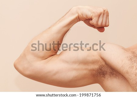 Strong male arm with biceps. Close up photo - stock photo