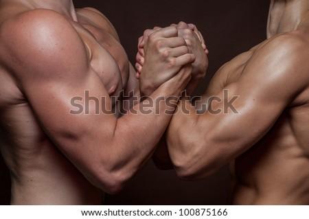 Strong male handshake - stock photo