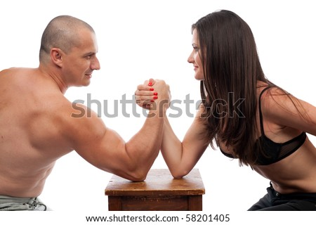 Strong man and woman doing arm wrestling isolated on white - stock photo