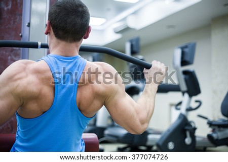 strong man holding barbell on your shoulders in gym