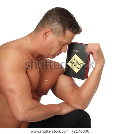 Strong Man Holding Holy Bible on Bicep - stock photo