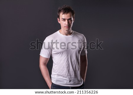 strong man in T-shirt - stock photo