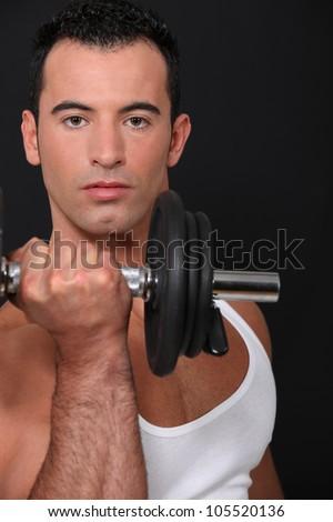 Strong man lifting barbell - stock photo