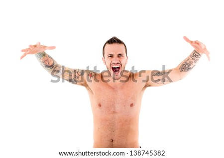 strong man  shouting and roaring with tattoos - stock photo
