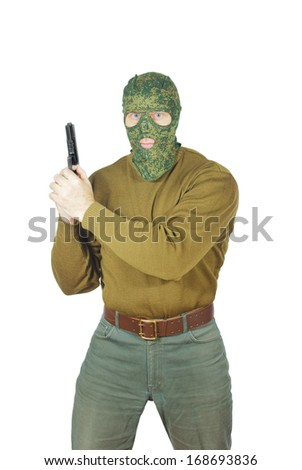 Strong man wearing camouflage mask with a gun