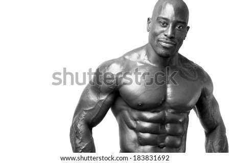 Strong man with perfect abs, shoulders,biceps, triceps and chest. Isolated on white background. Bodybuilder with six pack - stock photo