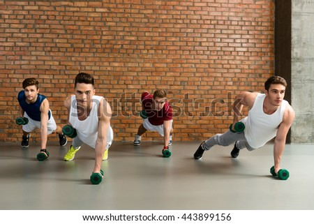 Strong men training with weights - stock photo