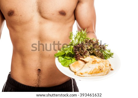 Strong muscular Asian man with clean food  isolated on white background - stock photo