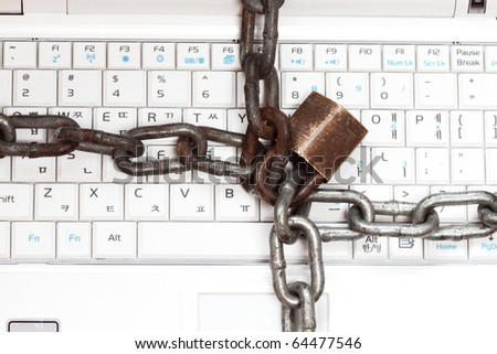 Strong Security Lock & Chain on PC keyboard - stock photo
