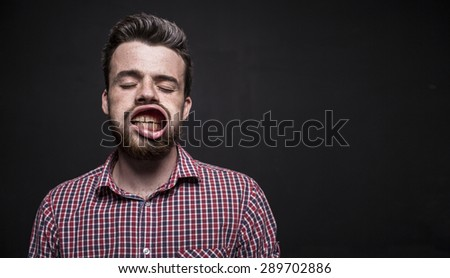 strong wind flow to the face. The guy makes faces - stock photo
