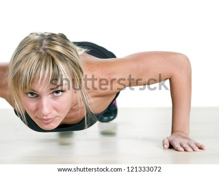 strong woman doing push-up - stock photo