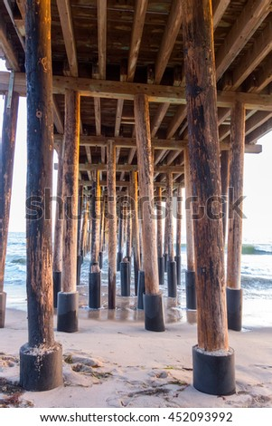 Strong Wooden Pylons underneath of Ventura Pier, city of San Buena Ventura, Southern California