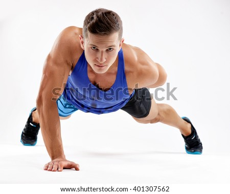 Strong young athlete doing push-ups on one hand. Sports concept.  - stock photo