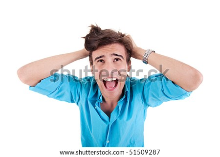 Strongly afflicted young man, screaming and pulling hair, isolated  on white background. Studio shot - stock photo