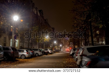 Strsburg Night city, roadway , cars are parked along the road lighting street lights - stock photo