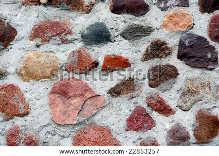 Structure from stones built in concrete - stock photo